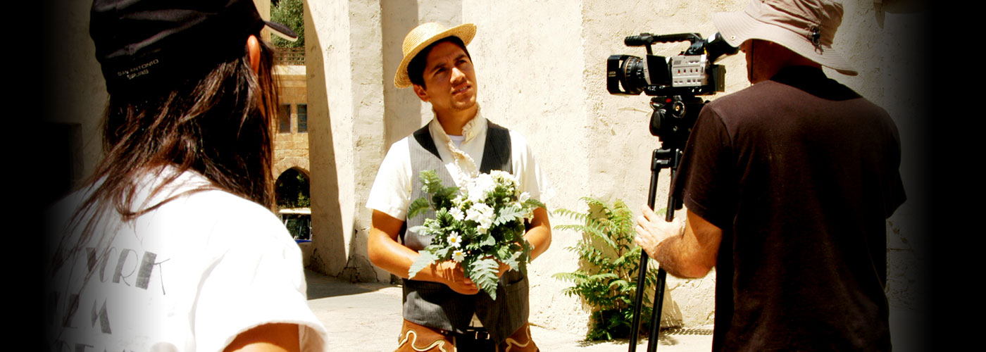 Student holds flowers at NYFA Miami's acting workshop
