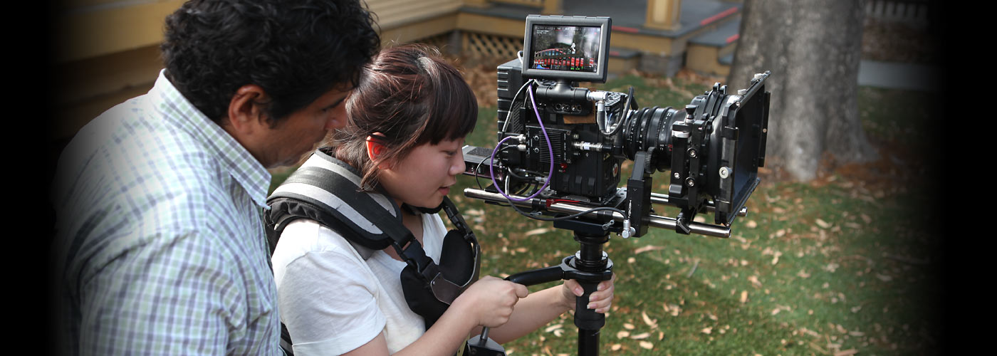 NYFA South Beach instructor assists student with camera