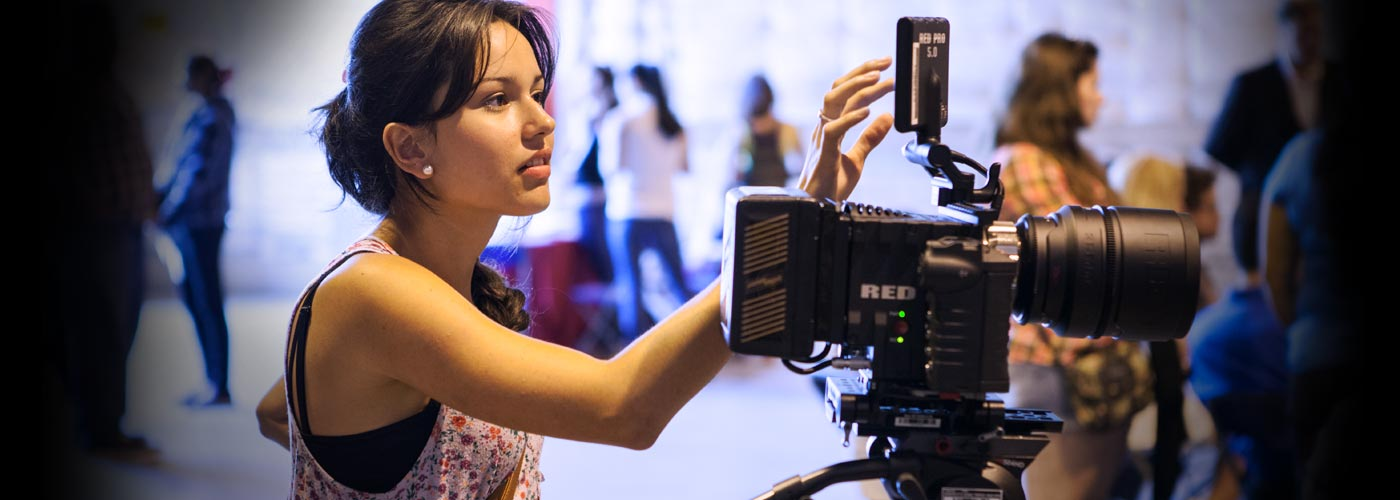 Film school student works with a RED digital camera