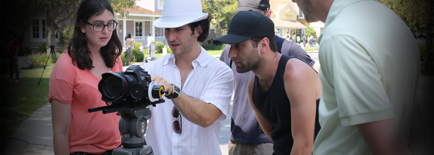 NYFA Miami film workshop students work with a digital camera
