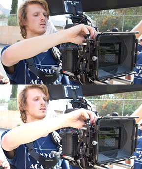 An MFA film student works with a RED digital camera