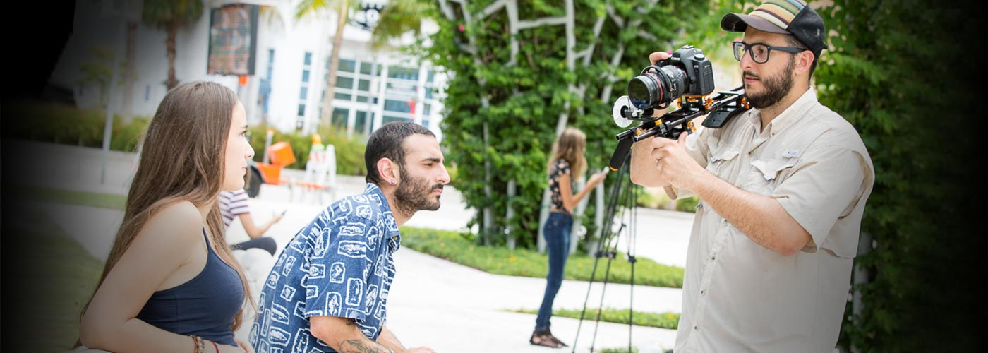 Film workshop students film a scene at NYFA Miami