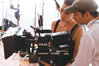 Students work with camera at NYFA Miami's film school